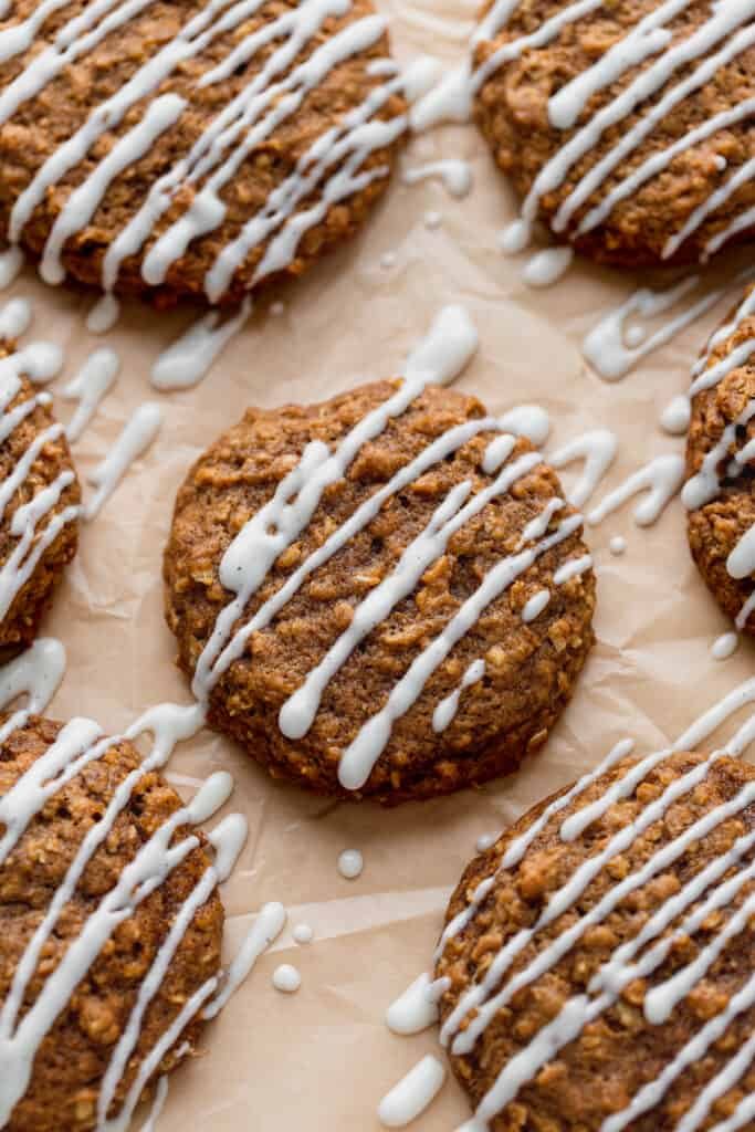 Pumpkin oatmeal cookies on parchment paper.