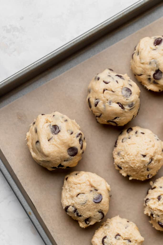 Rolled cookie dough on cookie sheet.