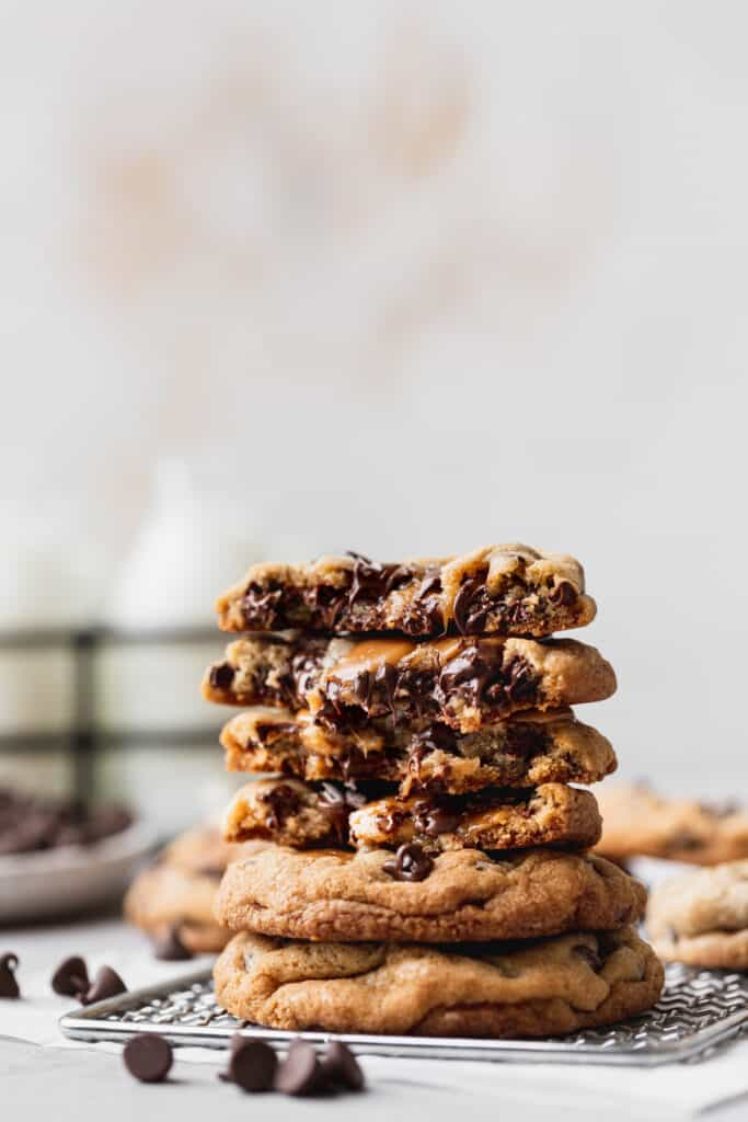 Stack of gooey caramel chocolate chip cookies.