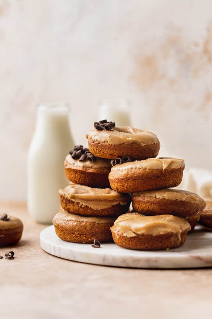 Stack of pumpkin donuts with maple glaze.