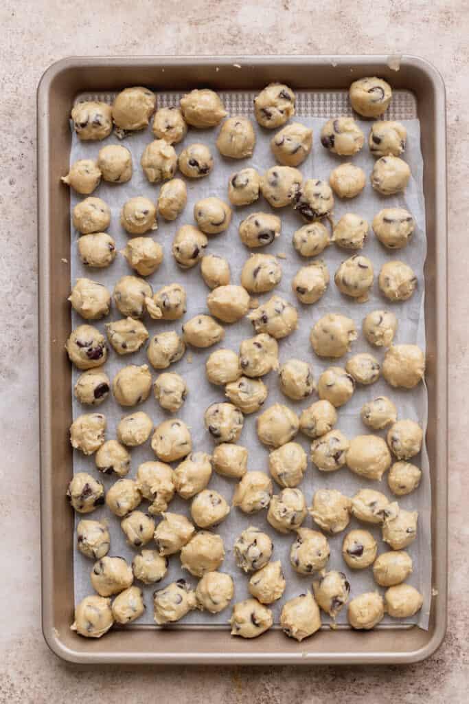 Cookie dough balls on a cookie sheet.