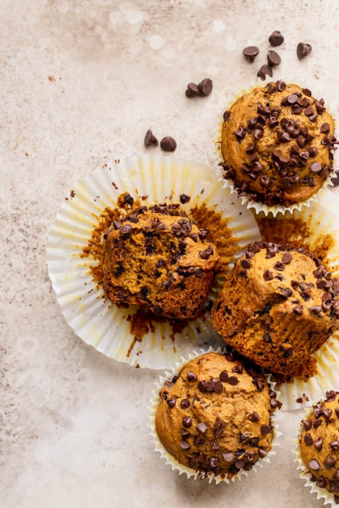 Array of muffins with a bite missing.