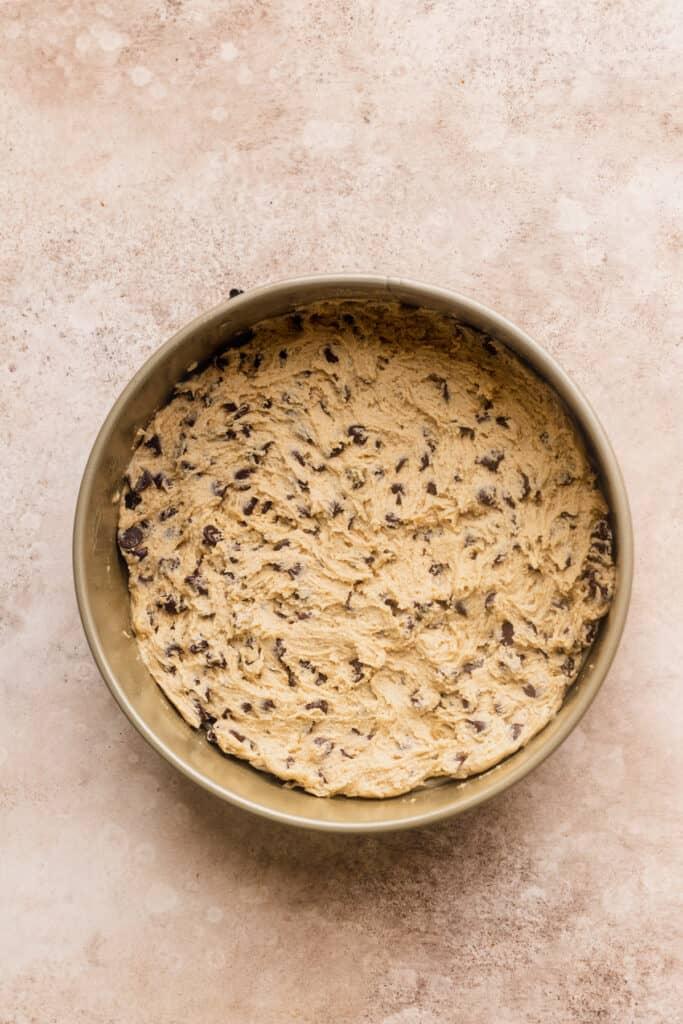 Cookie dough in a springform pan.