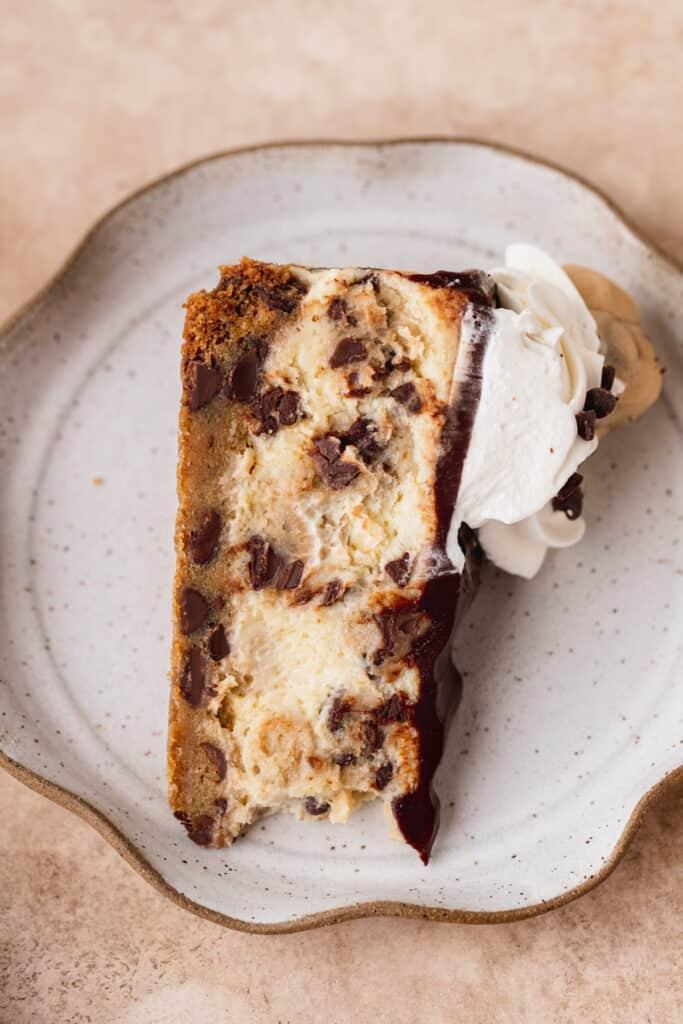 Cheesecake slice on top of cake slice,
