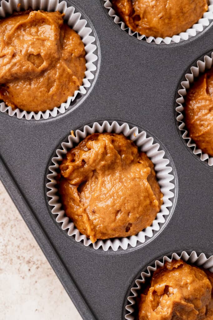 Batter in a muffin pan.