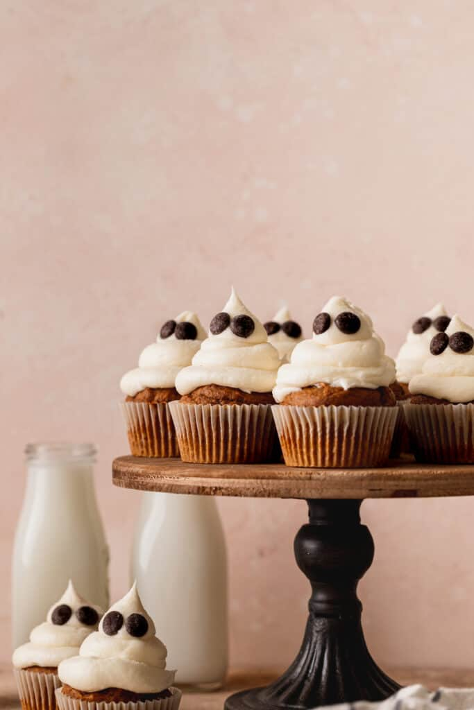 Ghost cupcakes on a cake stand.