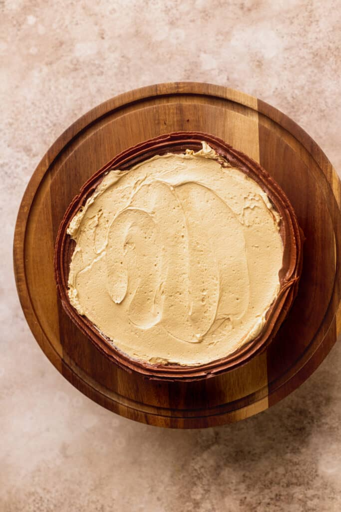 Butterscotch ganache on top of cake.