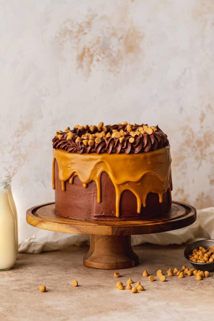 Chocolate butterscotch cake on a cake stand.